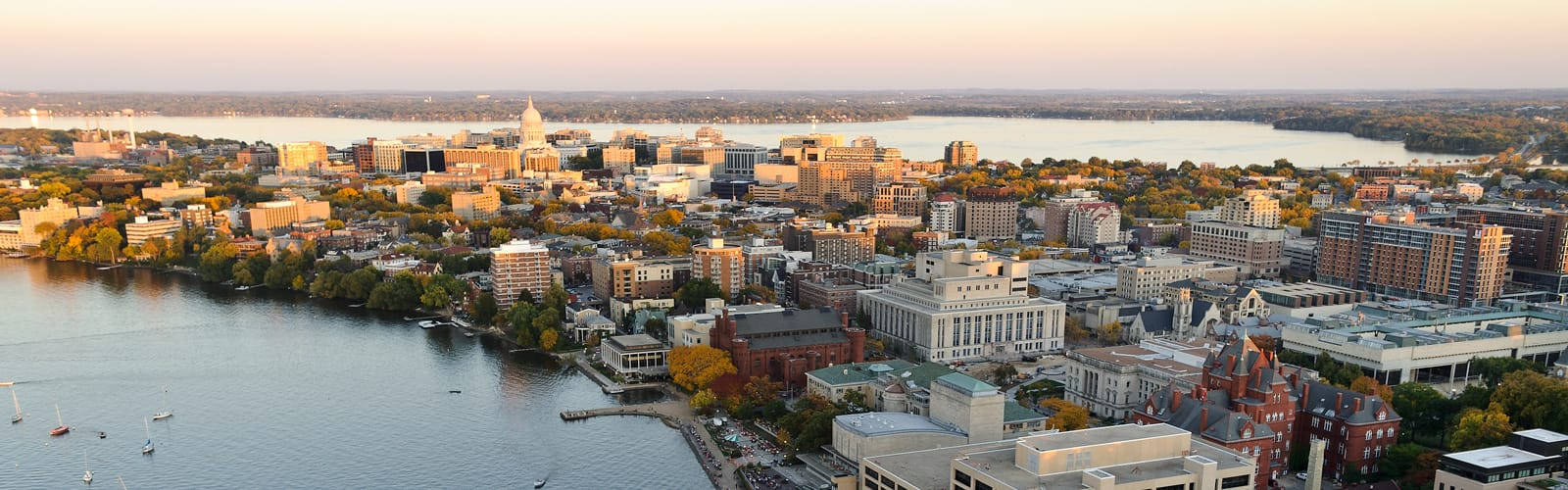 Aerial photo of campus and downtown Madison with Lakes Mendota and Monona