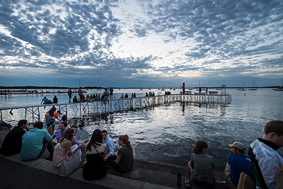 People enjoying a sunset along Lake Mendota