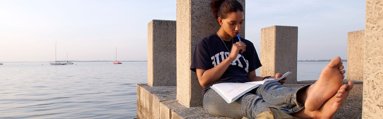 Student sitting alongside Lake Mendota