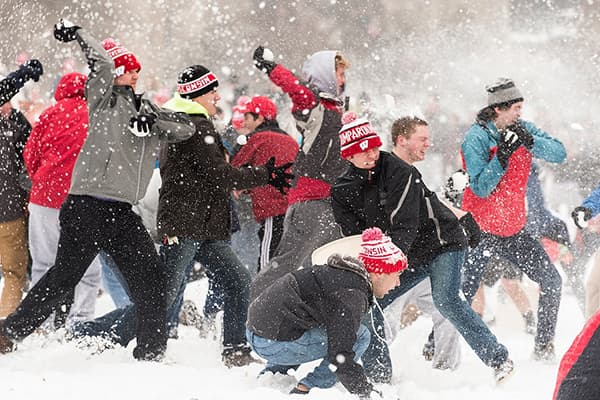 Mass of students having a snowball fight on Bascom Hill