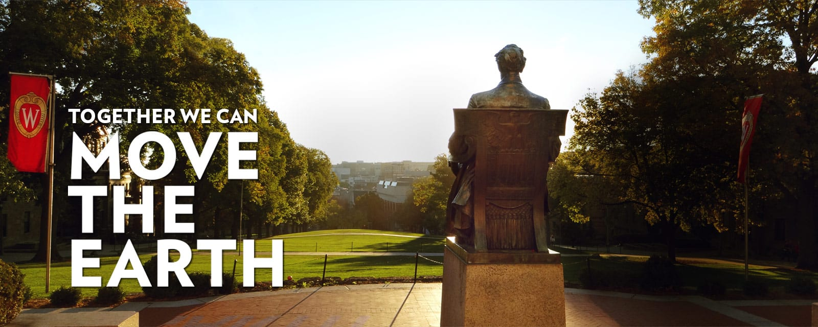 Photo from behind the Lincoln statue looking down Bascom Hill with the words together we can move the earth