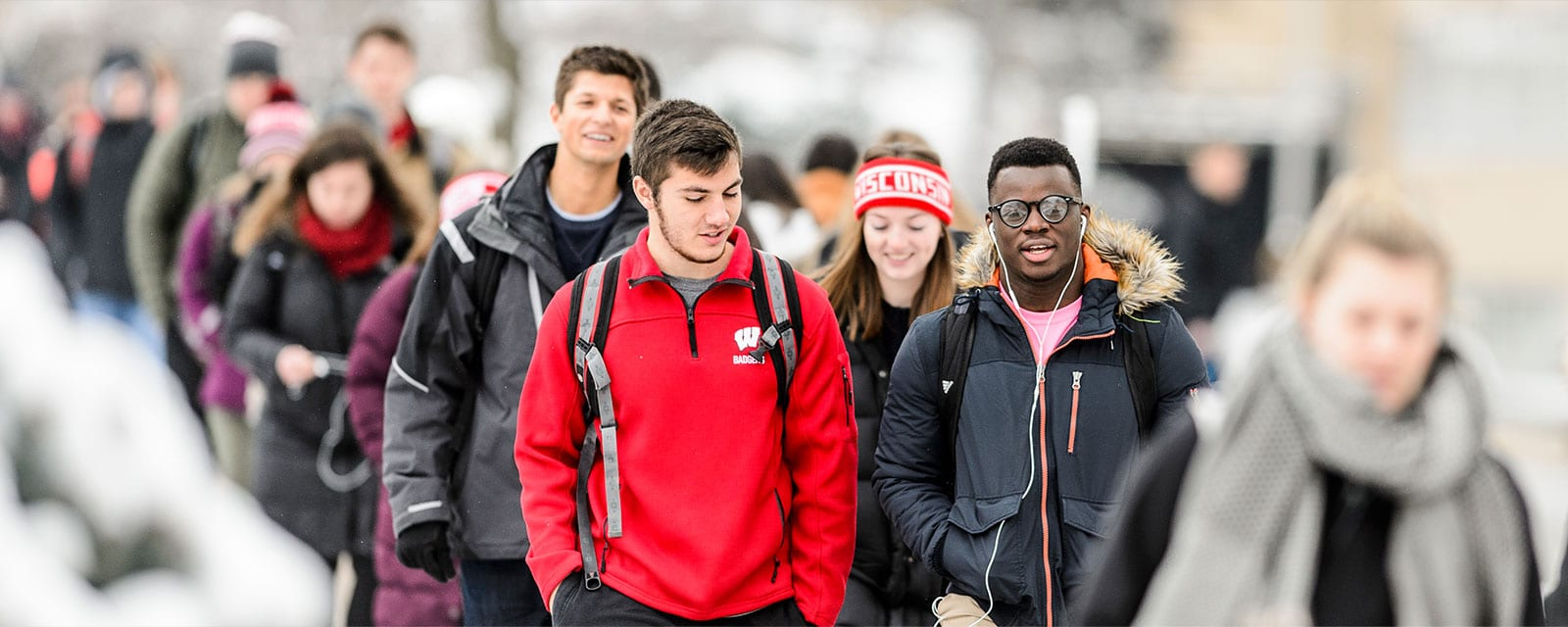 Students walking up Bascom Hill in the winter