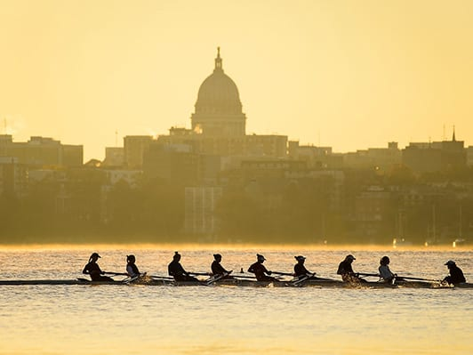 Crew team on Lake Mendota with capitol building in background